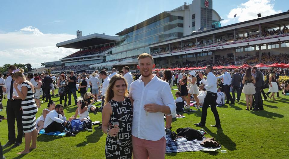 two racegoers pose for a photo at the Melbourne Cup Carnival