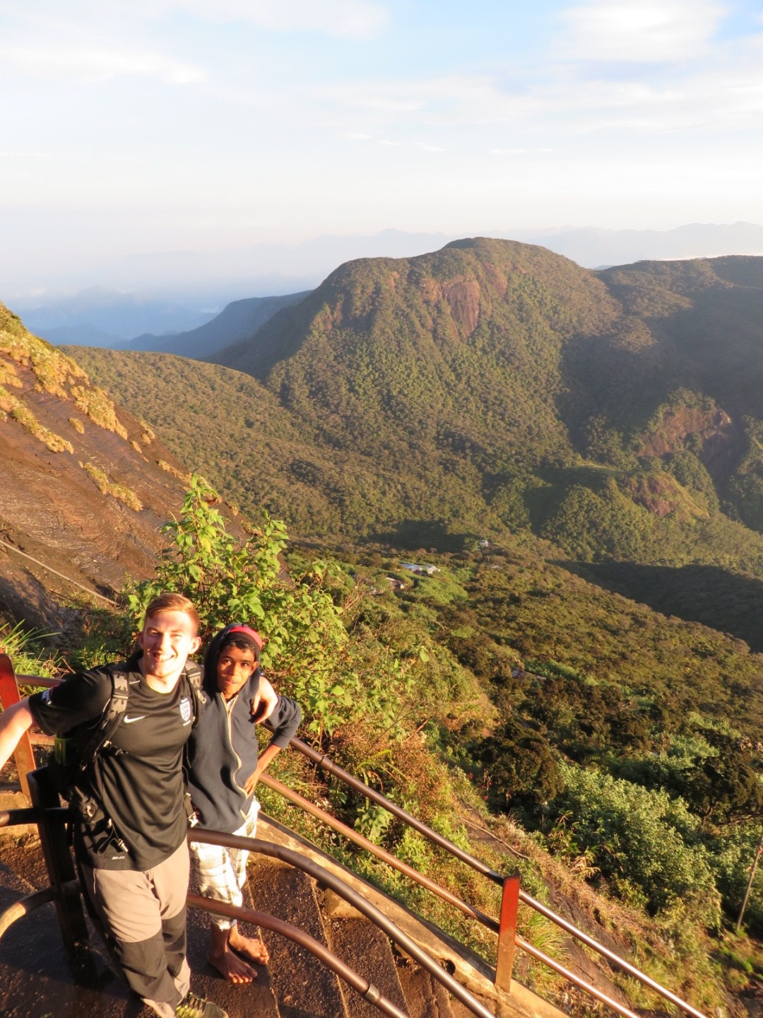 james stands with a local lad who was climbing Adams Peak with a friend