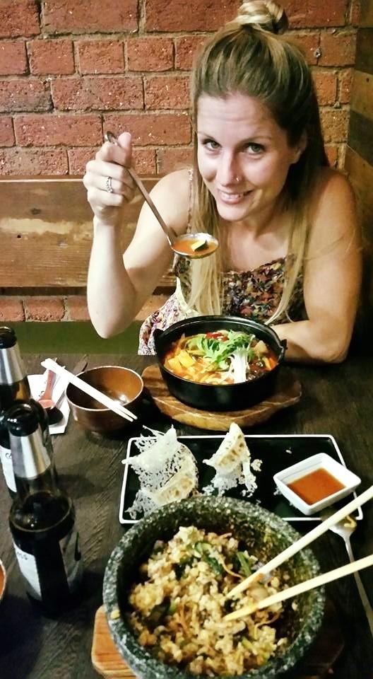 a diner eating Korean food at a restaurant in Melbourne